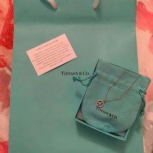 Tiffany & Co Sterling Silver Peace Sign necklace.